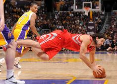 Luis Scola dives for a loose ball vs. the Lakers