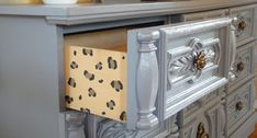 Give a thrifted dresser a wild touch with DIY secret leopard spots.