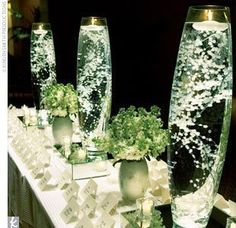 Baby's Breath submerged in water & topped with floating candle