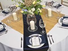 Portland-based wedding and event florist Frank Blanchard of La Vie Flowers joins LinenTablecloth in another wedding table linen inspiration video. Using a white tablecloth and navy blue accents we have created a beautiful nautical tablescape theme, one that works perfect for any wedding or special event taking place along a lake or ocean or anywhere!