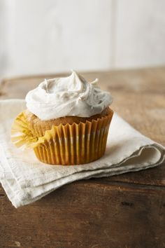 Pumpkin Cupcakes with Cinnamon-Cream Frosting -- What could make a moist pumpkin cupcake better? Cream cheese frosting spiced with cinnamon, of course! Make this fall-inspired dessert recipe for your next get-together!