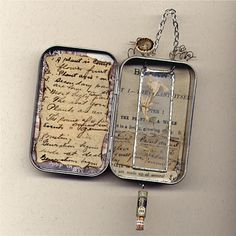 Altered Altoids Tin with micro slide suspended inside.