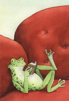 frog reading a book on a red sofa