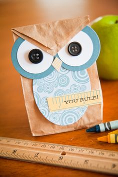 easy to make with small paper bag, circle and buttons for eyes oval for belly and cut a small piece paper for beak...cute idea for school treats for halloween....have a hoot of a halloween!!!!