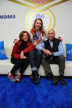Smiles all around! Mikaela Shiffrin with mom & dad, celebrate at the #PGFamily home after her Gold medal win!