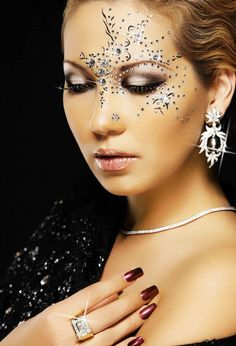 Elegant placement of crystals enhance a smokey eye with crystal eye lashes.