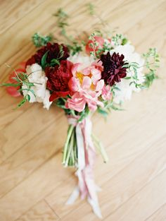 Peony + dahlia bouquet.  Love the pretty pink ribbon around the handle.  Bouquet designed by JMFlora Design and captured by Laura Gordon Photography.