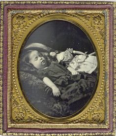 ca. 1850s beautiful post-mortem daguerreotype portrait of a child with her doll.