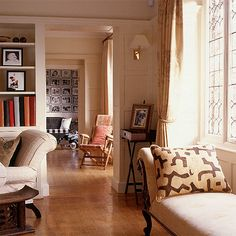 Neutral living room + warm accents + pattern