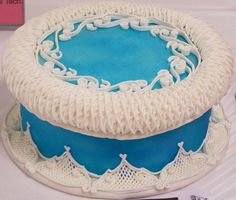 Lambeth method stringwork, lattices, overlay and puffs on blue fondant.  All piped with tips 1, 2 & 3.