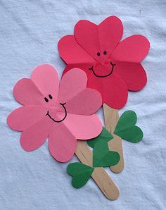 kids crafts hearts attached to Popsicle stick to make a flower