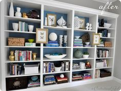 Ikea Billy bookcases used for built-ins -- backed with teal paint = half 'Pewter' and half 'Venezuelan Sea' by Benjamin Moore and styled.