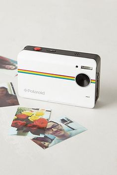 Polaroid Instant digital camera. Makes instant digital tiny prints. Would be so fun to have for summer/road trips/camping.