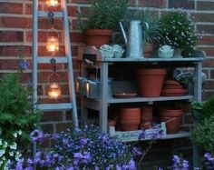 Love the ladder with mason jar candlelight.