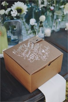 calligraphy on dinner boxes by the pretty paperie #weddingpicnic #boxeddinners