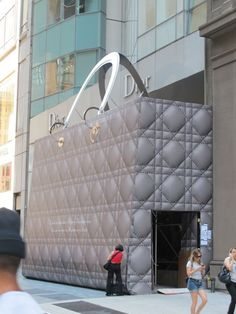 The Christian Dior store in New York is closed for a re-do and the facade is now a GIANT silver Lady Dior Top Handle Handbag.  http://www.arcreactions.com/