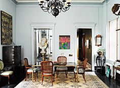 Rugs 101: Your Ultimate Guide to Rug Shopping // dining room, chandelier, glass dining table