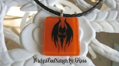 Orange Evil Bat Stained/Fused Glass Necklace.  Image is permanant and as such will NOT scratch off. $40.00  To see more wicked glass addictions go to http://WickedBadNaughty.Etsy.com