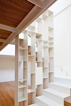 White Metal Stair around shelves