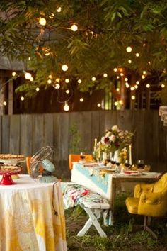 cozy romantic outdoor dining. I love the potted herb place setting on this blog