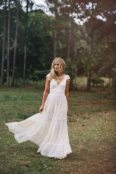 Gorgeous boho wedding gown, head piece and necklace by Grace Loves Lace.