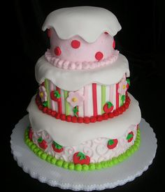 Strawberry Shortcake cake. This makes me smile. I had a Strawberry Shortcake room when I was a little girl.