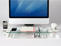 The U Board provides an easiest way to organize your work space. It is made for hiding a keyboard not in use and for putting gadgets on its glass plate. The device also has a cup holder that can be installed on the right or left and three USB 2.0 ports on the left. #Apple #Tech