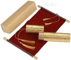 Royal Maroon velvet cloth scroll wedding card with golden bars. Love it!! Order it.  Order link- http://indianweddingcard.in/sc611.html