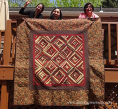 """In good and bad...   Machine Pieced, Free Motion Quilting.  65""""X 65""""  Quilts by Marisela original design.  PS.  In case you were wondering, """"how did you hang the quilt over the deck and take such a good picture?"""" here is my secret:  Maria, Gloria and Clara were squatting down while holding it from behind so I could shoot it!  Thank you to my smiley helpers!"""