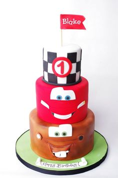 Cars Cake with 3 on top layer and gavin name on flag love this