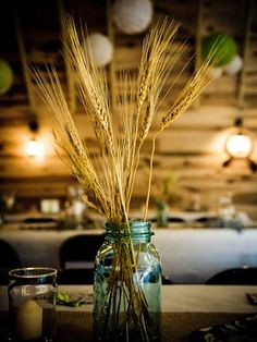Harvest centerpiece in seconds with wheat and mason jars.