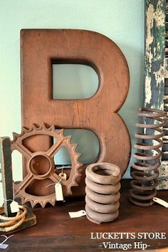 industrial spring, gear, wooden letters