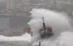 Waves batter a merchant vessel stranded along the coast during a heavy storm in Valparaiso City, Chile, 121 km (75 miles) northwest of Santiago on July 6, 2010. (REUTERS/Eliseo Fernandez) #