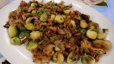Emeril Lagasse's Pan-Roasted Brussels Sprouts with Caramelized Onions and Crispy Pancetta