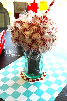 Cute centerpiece at a 1950's Diner Party via Kara's Party Ideas - I want to do for my candy cane room.
