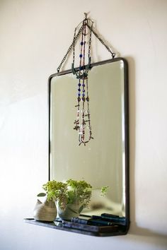 small space idea...  mirror w/its own shelf = just that much more storage...