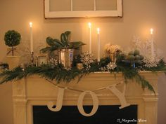 White, silver and green mantel in historic house from 11 Magnolia Lane, plus pretty Christmas vignettes in the kitchen and on the wet bar.  Lots of nice vintage touches.