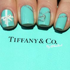 Tiffany & Co. nails- Like the turquoise & silver stripes that are off-center, diagonal & low on the nail.