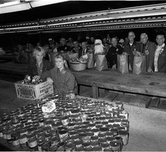 LAPD annual Christmas basket drive, 1986. The Los Angeles Police Department, with help from volunteers, creates baskets for the needy. San Fernando Valley History Digital Library.