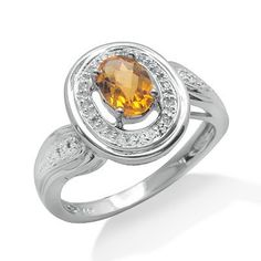 This lightweight and comfortable ring features an oval shaped prong set citrine gemstone. The gemstone is accented by prong set round brilliant diamonds. The 14k white gold band gives a beautiful shine.Different ring sizes may be available. Please inquire for details. $186.00