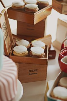 cupcakes served in cigar boxes.
