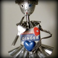 Super cute robot girl made from repurposed metal objects. Clever!