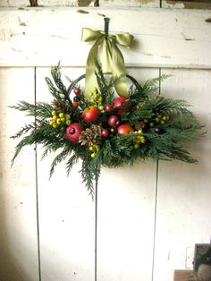 Colonial Christmas Basket - Holidays- Christmas Front Door Decor - Winter - Traditional - READY TO SHIP. $75.00, via Etsy... excellent transitional décor from fall to Christmas with al the fruit in it (just add a few gourds and fall leaves that can be easily removed after Thanksgiving)