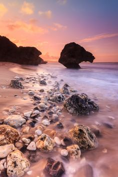 Glowing pink sunset in Bathsheba Beach, Barbados.