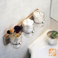 Reclaim your bathroom sink with this DIY mason jar storage solution! Click through for more clever and affordable storage ideas. decor, storage solutions, masons, idea, bathroom storage, bathrooms, hous, mason jars, diy