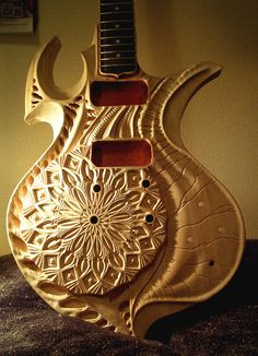 This custom guitar is hand carved from wood by vankuilenburg.