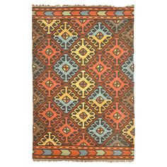 Anchor your patio dining set or living room seating group in chic style with this hand-woven kilim rug, showcasing a fringed edge and an eye-catching geometr...