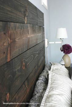 Home Depot stocks 6′ long pre-cut boards for about $5.50 a piece. It took six boards that she stained then screwed them to the wall using a course drywall screw. headboard