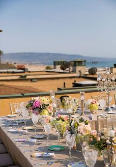The rooftop wedding reception had a stunning view of the Pacific Ocean. Callaway Gable. Flowers by Butterfly Floral.