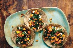 Butternut Squash, Kale, and Crunchy Pepitas Taco with Cashew Crema + more from Tacolicious //epicurious  For the filling: 3/4 cup finely chopped yellow onion 1 clove garlic, minced 3 cups 1/2-inch-diced butternut squash 1 teaspoon chile powder 2 teaspoons kosher salt 4 cups finely chopped kale Corn tortillas, warmed, for serving Cashew Crema: 2/3 cup raw cashews 1 teaspoon cumin seeds 6 tablespoons freshly squeezed lime juice (from about 3 limes) 1/4 cup water 2 teaspoons kosher salt